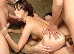 Katsuni starts by sucking a dildo cock and then joins in on a foursome of wild sex. She takes turns sucking all three of the cocks in the room and goe