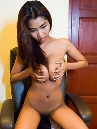 Huge Tits thai girl Tittiporn in schoolgirl skirt