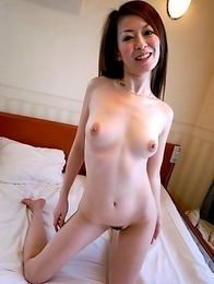 Yuu Sakura posing nude and spreading her legs to have a cock jammed inside her twat