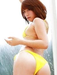 Misato Kashiwagi in yellow lingerie rubs pussy of bench
