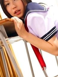 Kaori Ishii is naughty and shows legs under uniform skirt