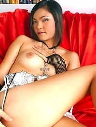 Wee Wansa is the symbol of sex appeal and she looks so hot in her sexy lingerie. She is posing on the red sofa and just pushing her tits in the screen