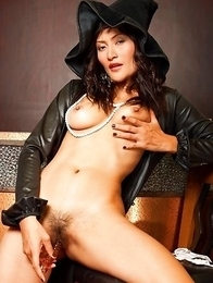 Bella Yong has on a sexy witch's costume with her blouse open. Her nipples are hard as her pearls split her chest.