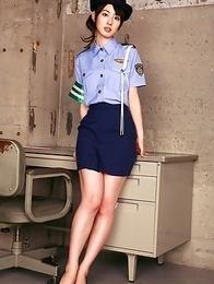 Rina Akiyama in police woman uniform exposes sexy legs