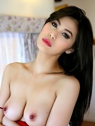Sexy Asian Natalie Wang fucks herself with a dildo
