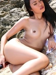Hot Oriental bebe Varinda Pan posing on  beach