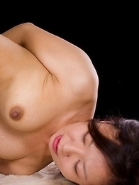 Pretty babe in pink Shizuka Maeshiro uses her feet to get this horny guy off