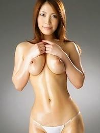 Sakura Kokomi takes clothes off and shows big oiled boobs