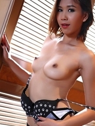 Oriental babe  Evita pushes her pussy with her fingers