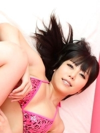 Maria Akamine shows big assets in pink lingerie in her bed