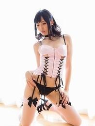 Stylish lass Natsuki Yokoyama shows her ass while kneeling on the floor