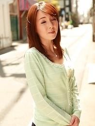 Chika Sasaki in green sweater and short skirt
