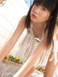 Hijiri Sachi in shorts and bra enjoys sun on her curves